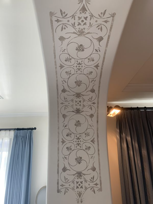 This design is on both sides of the archway between the living room and dining room. Can you spot the Hidden Mickeys?