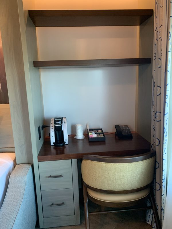 The writing nook houses the Keurig and the room phone.