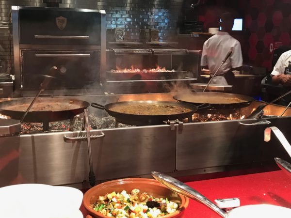 This on-stage kitchen works hard to prepare paella throughout the day!