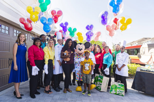 Mickey Mouse and Walt Disney World cast members pose with seven-year-old Jermaine Bell and his mother, Lauren Creech, during Jermaine's birthday party in Kissimmee, Fla. Photo credits (C) Disney Enterprises, Inc. All Rights Reserved