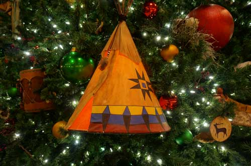 Disney fills the tree with unique ornaments like this illuminated teepee.