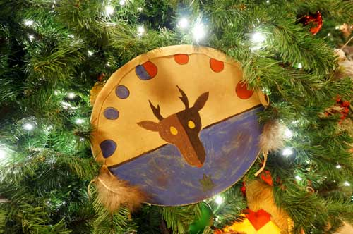 The ornaments combine the colors and artistic styles of Native American artwork.
