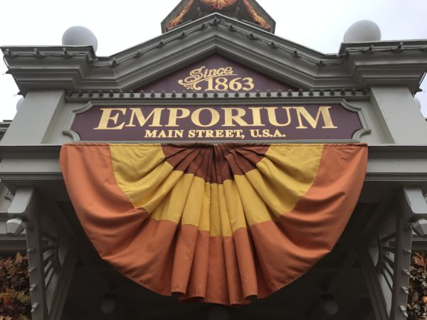 Fall bunting in orange, yellow, and brown decorates the Emporium.