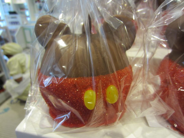 Their classic design is a Mickey apple. It's dipped in caramel and then milk chocolate, rolled in red sprinkles for the pants, and topped with two jelly beans for the pants buttons and two chocolate covered marshmallows for the ears.