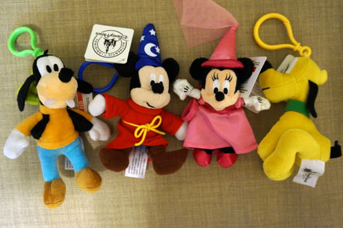 The prize pack includes four danglers - Goofy, Mickey Mouse, Minnie Mouse, and Pluto.
