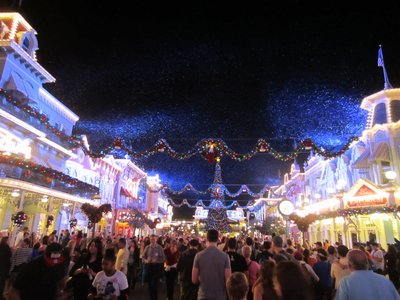 Get into the spirit of Christmas with snow on Main Street USA.