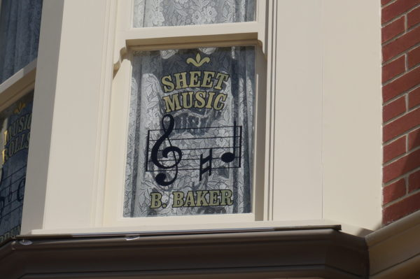 Buddy Baker was named a Disney Legend in 1998 for his contributions to Disney music history! He is remembered with this window above the Car Barn.