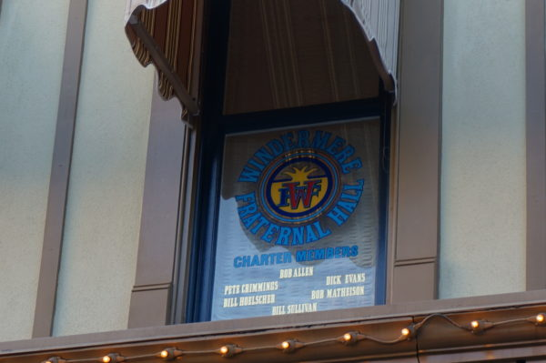 The window for Windermere Fraternal Hall honors the men who were part of Disney World's opening committee.