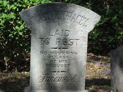 """Master Gracey, laid to rest, no mourning please, at his request""."