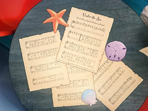 Embedded in the tabletop is the sheet music to Under The Sea!