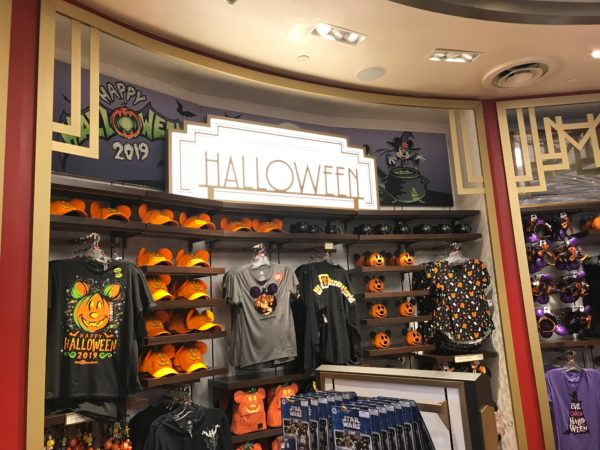 The store is organized into sections along the wall. You can see plenty of Halloween merchandise here.