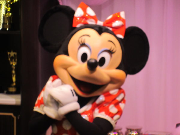 Imagine meeting Minnie Mouse with hair, makeup, and nails inspired by her outfit!