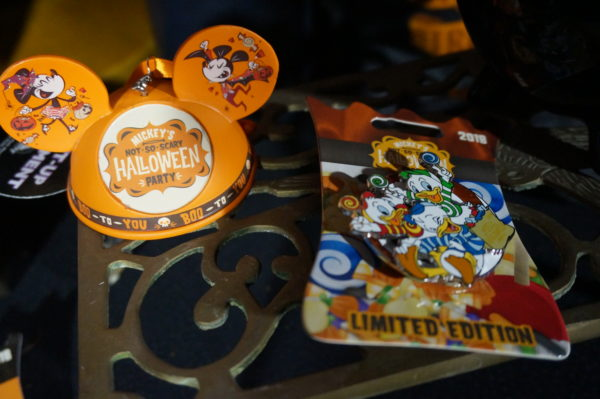 Here's a limited edition Duck Tales trading pin and an ear hat ornament!