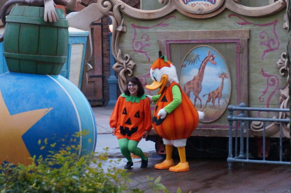 Disney characters are in their Halloween finest. So are some guests!