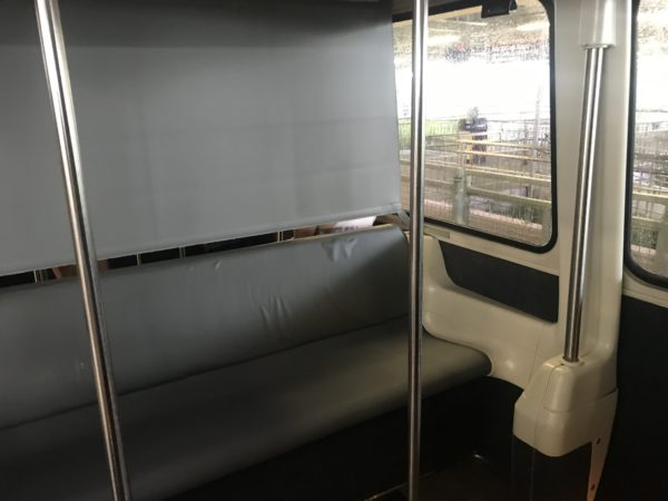 Disney has partitioned monorail cabins with separators.