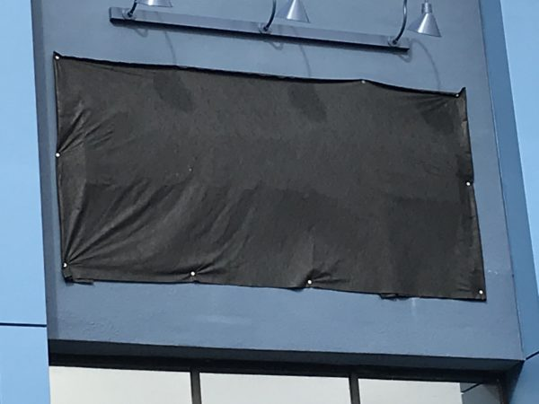 The MouseGear sign on the temporary location is covered in a black tarp, but if you look very closely you can see the outline of the MouseGear name.