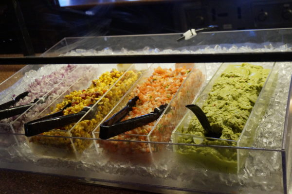 Once you order your fajitas, stop by the Fixins Bar and fill up on toppings!