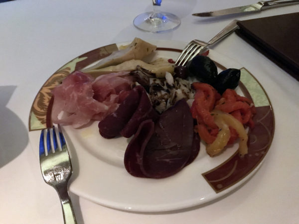 The antipasti salad is plated beautifully.