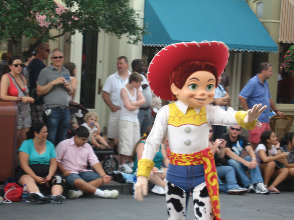 Jessie walks along the parade route in the Celebrate A Dream Come True parade.
