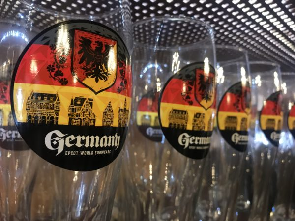 Glasses with a Germany EPCOT World Showcase design.