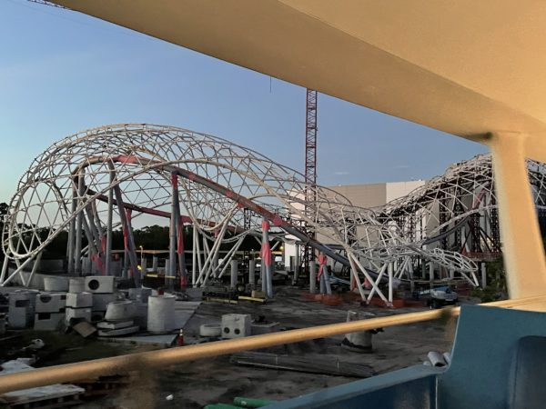We can once again get great views into the exterior construction of the Tron Coaster. The canopy is up, and the temporary support beams are coming down.