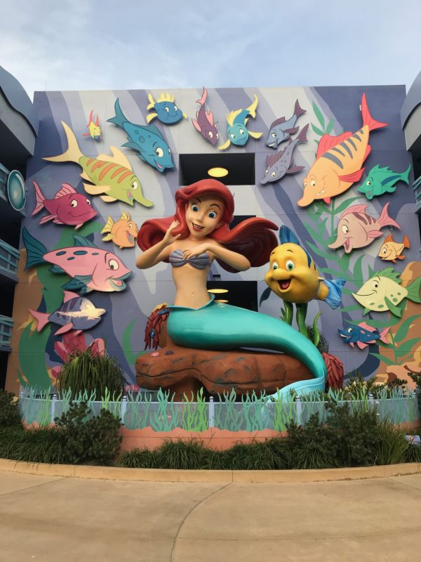Ariel and Flounder are having a great time swimming with the fishes!