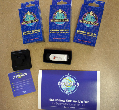 One lucky winner will get all these fun items - pins, USB drive, photos, and D23 access key.