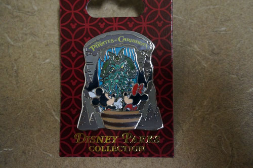 This pirate-themed pin includes Mickey Mouse and Minnie Mouse in a boat.
