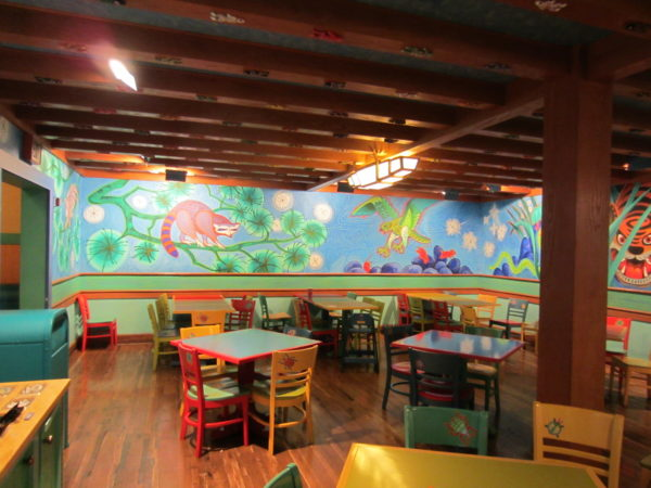 Dine family-style in one of Pizzafari's colorful dining rooms!