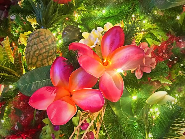 Beautiful flowers adorn the Christmas tree.