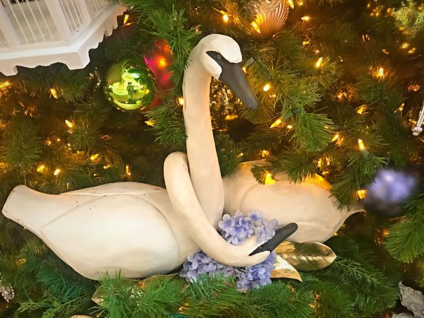 The Christmas tree is filled with Victorian images, like these swans.