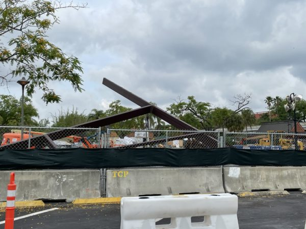 Some large pieces of steel are still staged in the park lot, waiting to be installed.