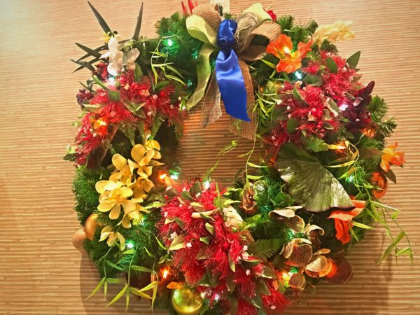 Check out this delightful wreath full of beautiful Hawaiian flowers.