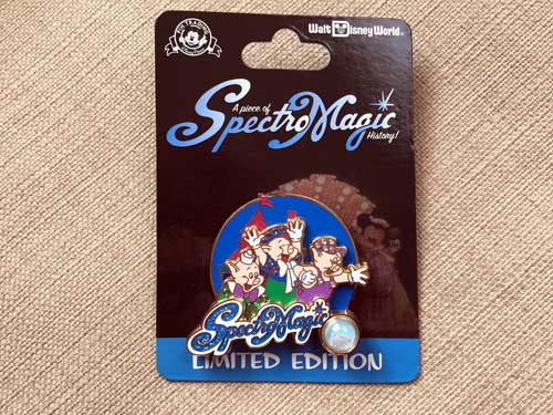 Limited Edition SpectroMagic pin with a piece of a costume in the pin itself.