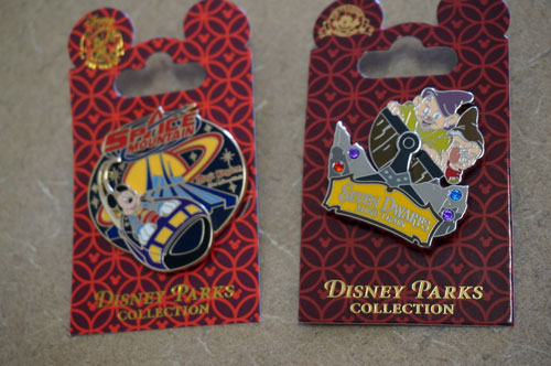 Space Mountain and Seven Dwarfs Mine Train pins.