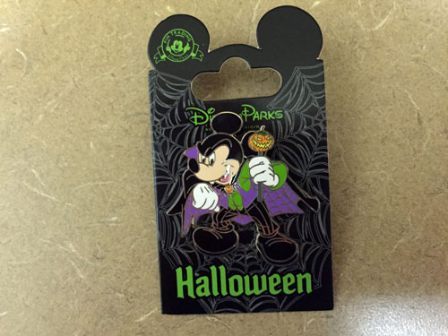 Halloween Mickey Mouse with purple cape.