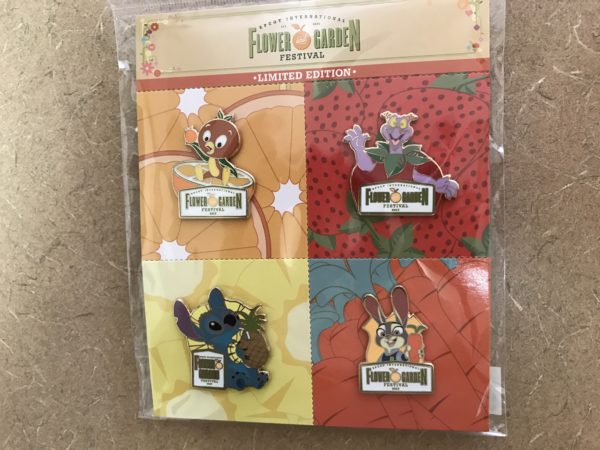 This four pack of pins features four Disney characters with the Flower and Garden Festival sign.