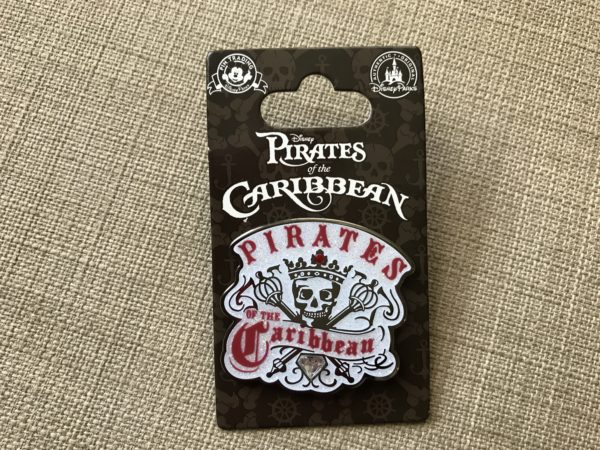 Pirates of the Caribbean pin with white glitter background.