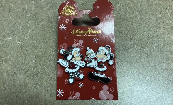 Mickey and Minnie Mouse dressed as Santa and Mrs. Claus.