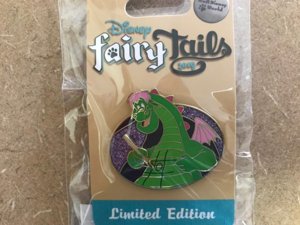 Pete's Dragon trading pin featuring Elliot playing tic-tac-toe on his tummy.