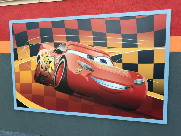 Lightning McQueen's Racing Academy poster in the courtyard.