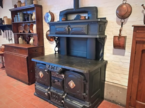 Kitchen appliances and accessories from a bygone era line the walls as well.
