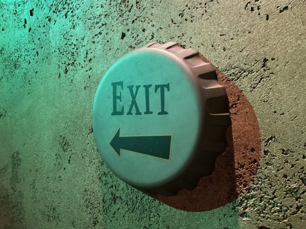 The bottlecap exit sign shows the way out.
