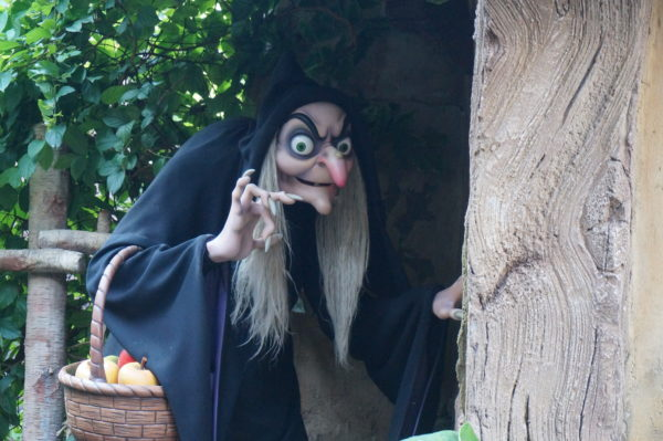The witch is still trying to get Snow White to eat the poisoned apple!