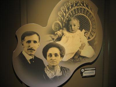 Photo of Walt at 10 months old together with his parents.