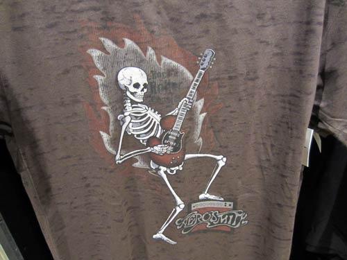 Skeleton playing a guitar.