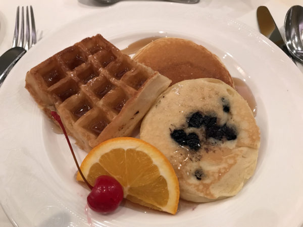 Waffles, pancakes, pastries, and fruit are all included on the breakfast menu.