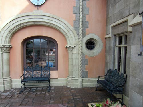 There are many places to sit in the shadow of Cinderella Castle, like at these benches near the Sir Mickey's gift shop.