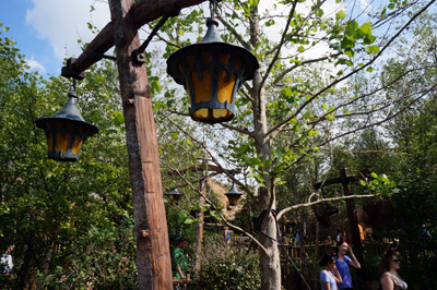Much of the queue is outdoors and winds through a forest.