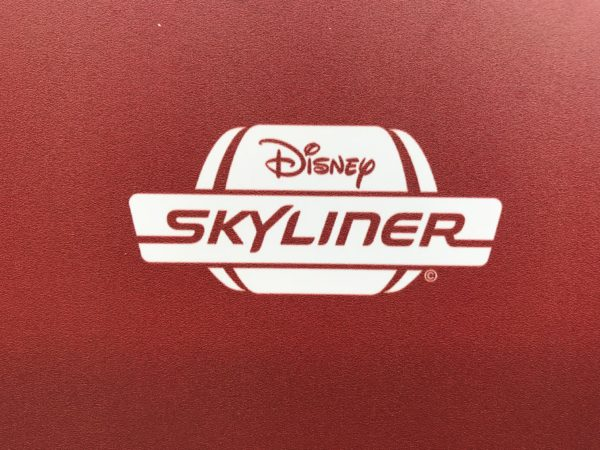 This concept art shows one of the logos for the Disney Skyliner.